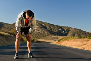 getty_rf_photo_of_man_with_back_pain_after_strenuous_jog